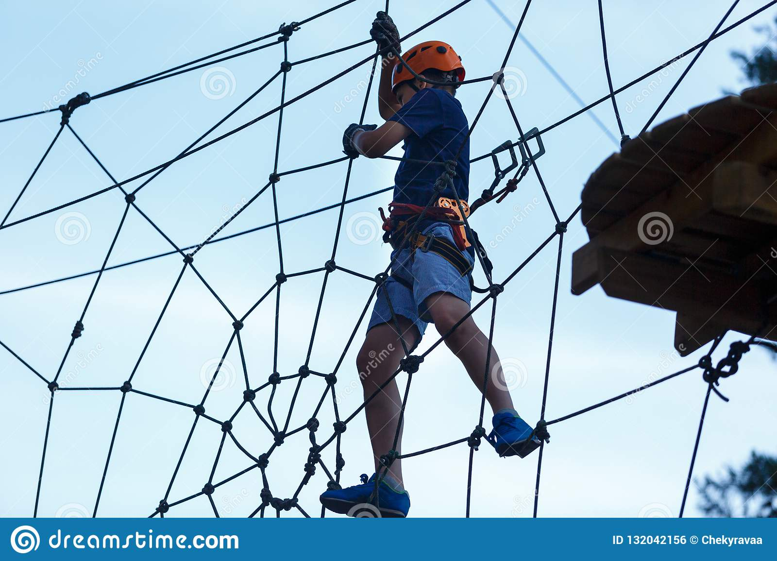 separation shoes e27e2 1cbbc Cute Young Boy In Helmet With Climbing Equipment In The Rope ...