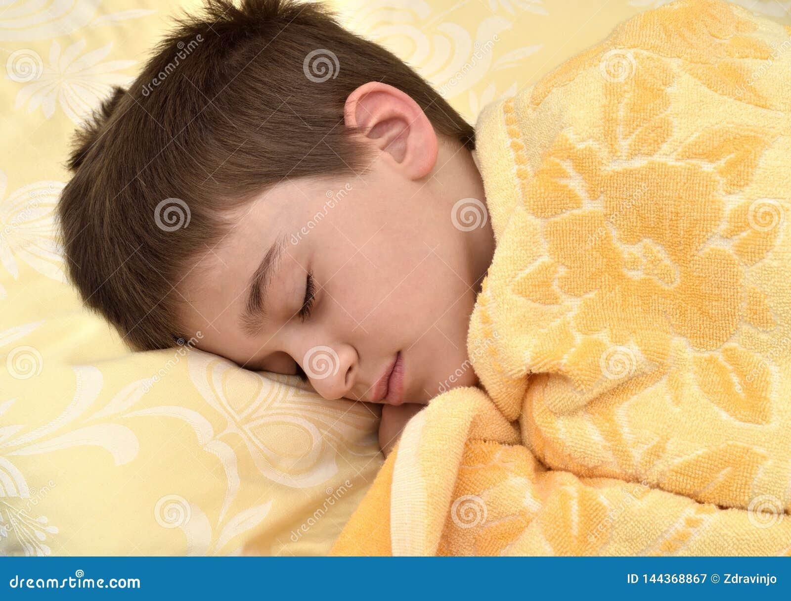 Cute young boy sleeping