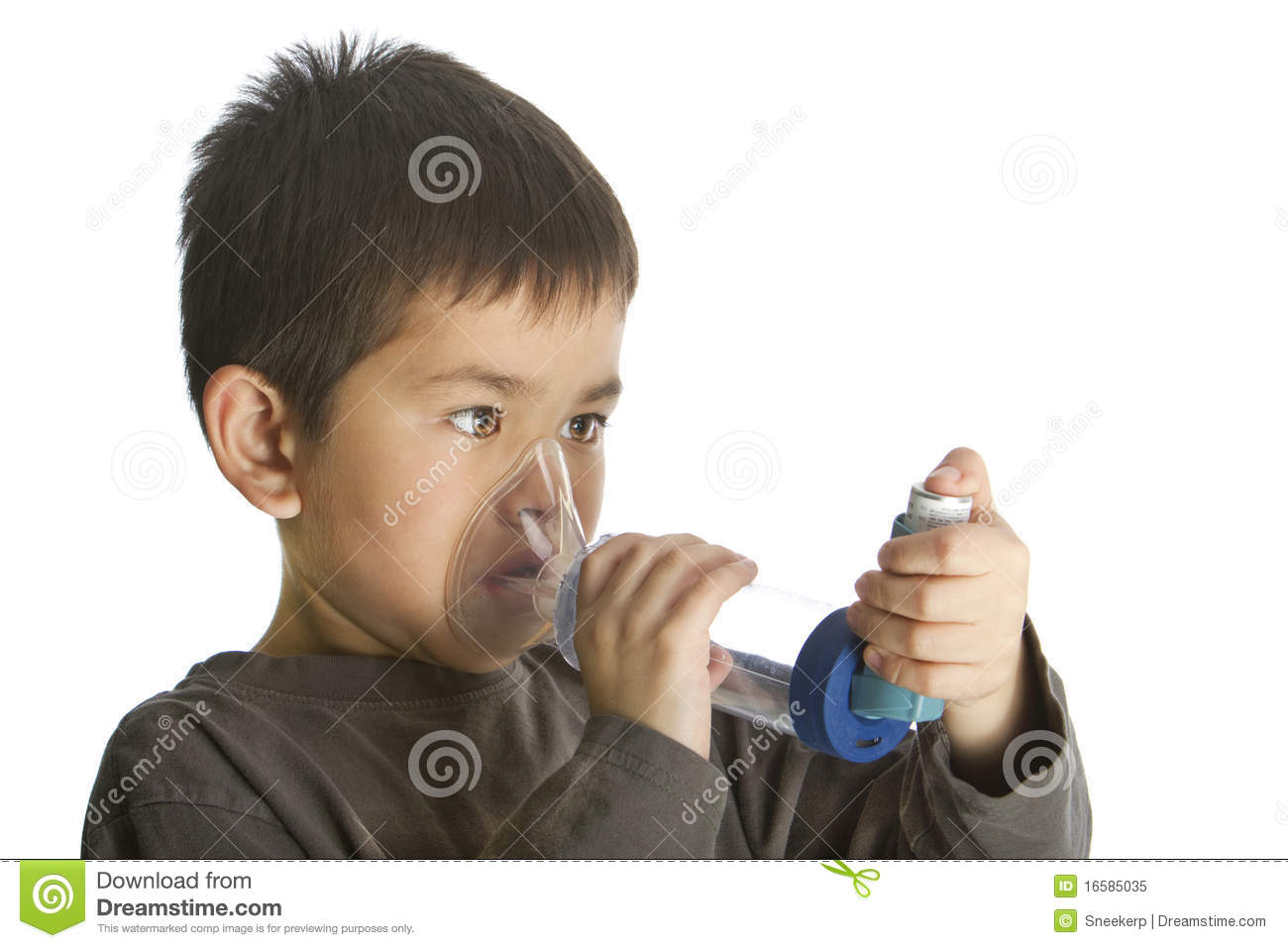 Cute young boy using his asthma inhaler