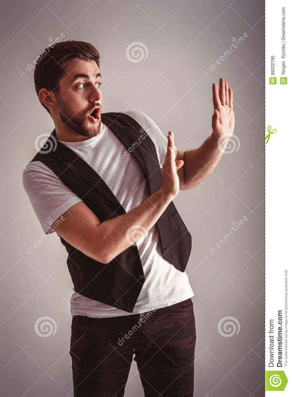 frightened young man on white background stock photography