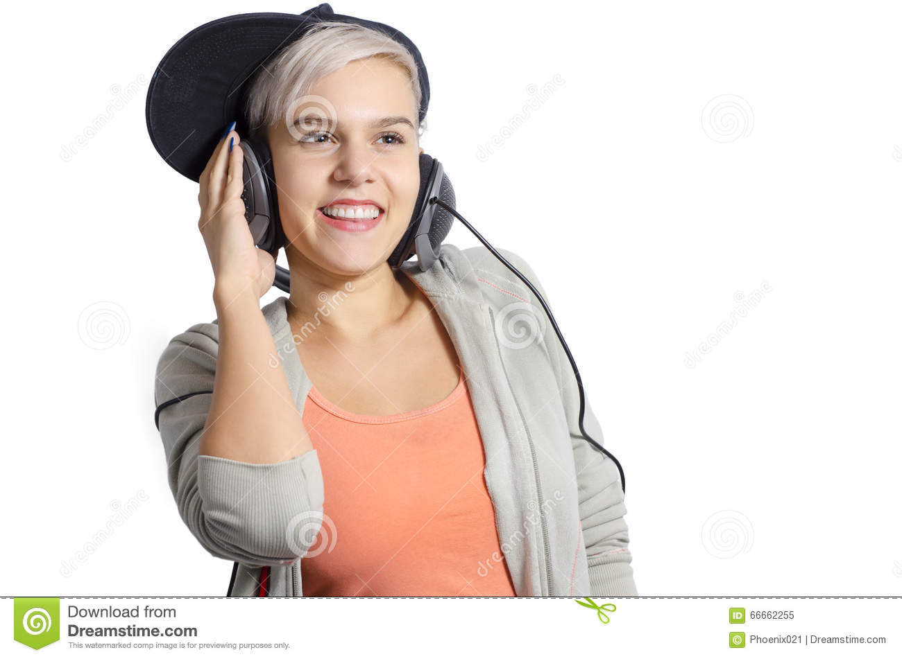 Cute young girl listening to music on headphones