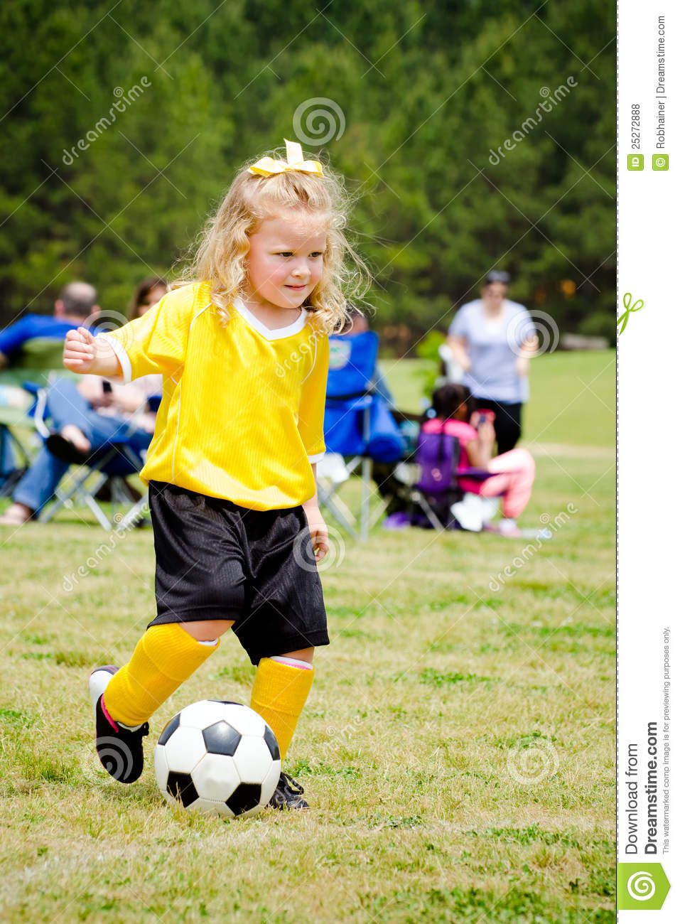 5f4720498 Cute young girl in uniform playing in organized youth league soccer game