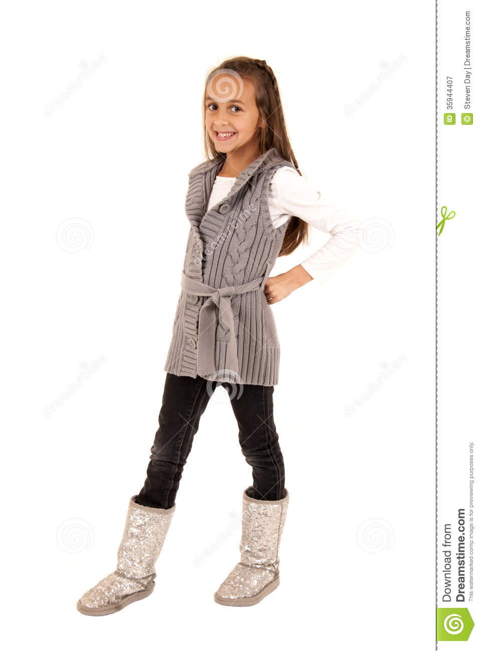 Cute Young Girl Wearing A Sweater And Winter Boots Royalty