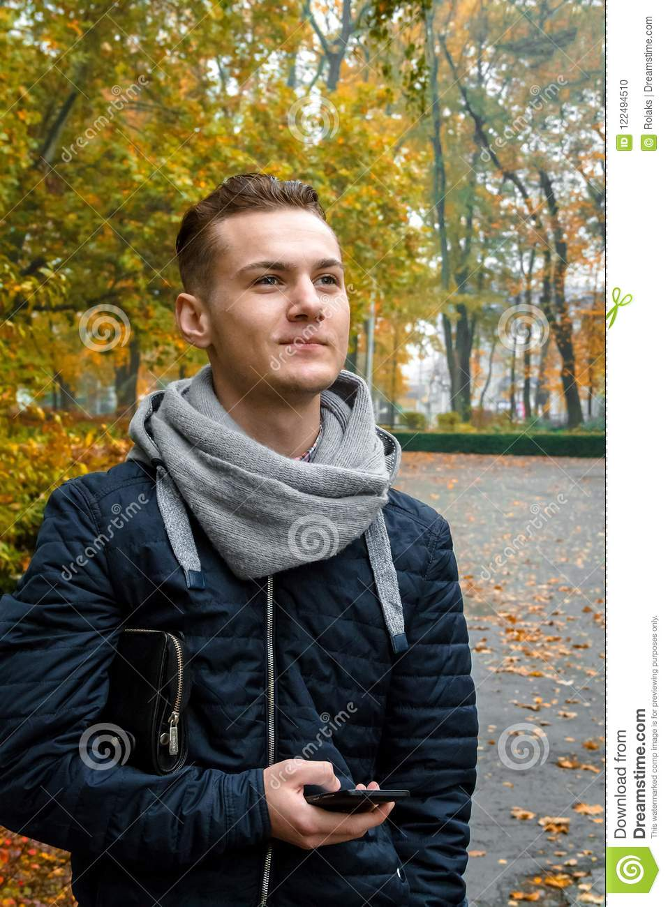 Cute young man with smartphone