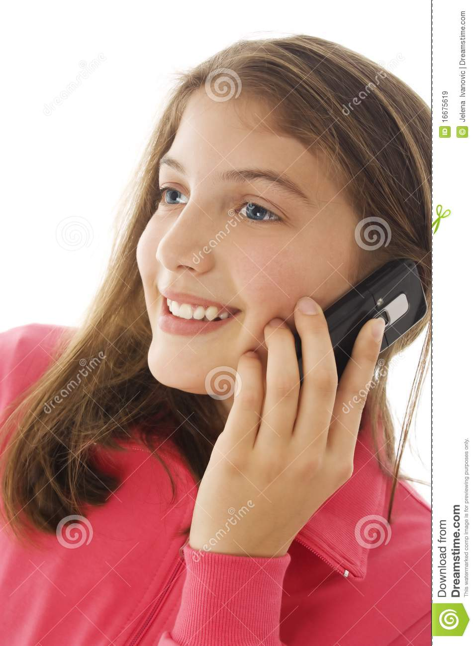 Cute young teenage girl talking on a cellphone