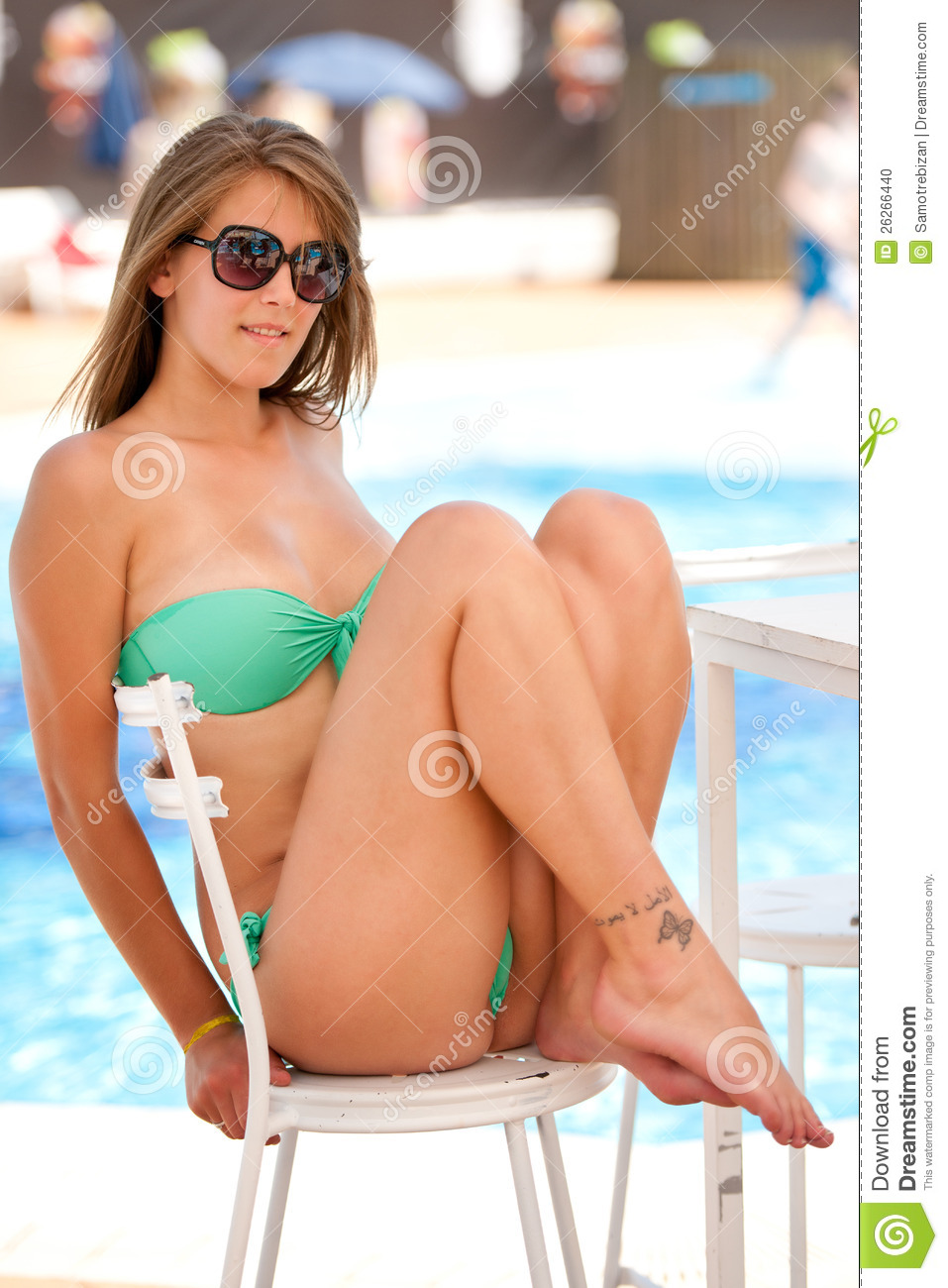Cute Young Woman Resting Near Swimming Pool Stock Photo - Image: 26266440