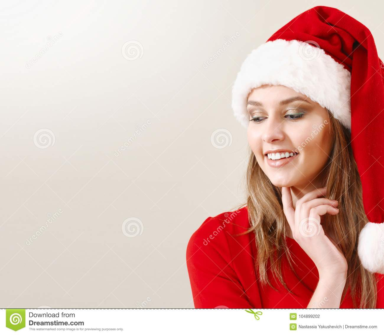 2d3782018e76a Cute Young Woman In Santa Hat Dreaming About Christmas Gifts Stock ...