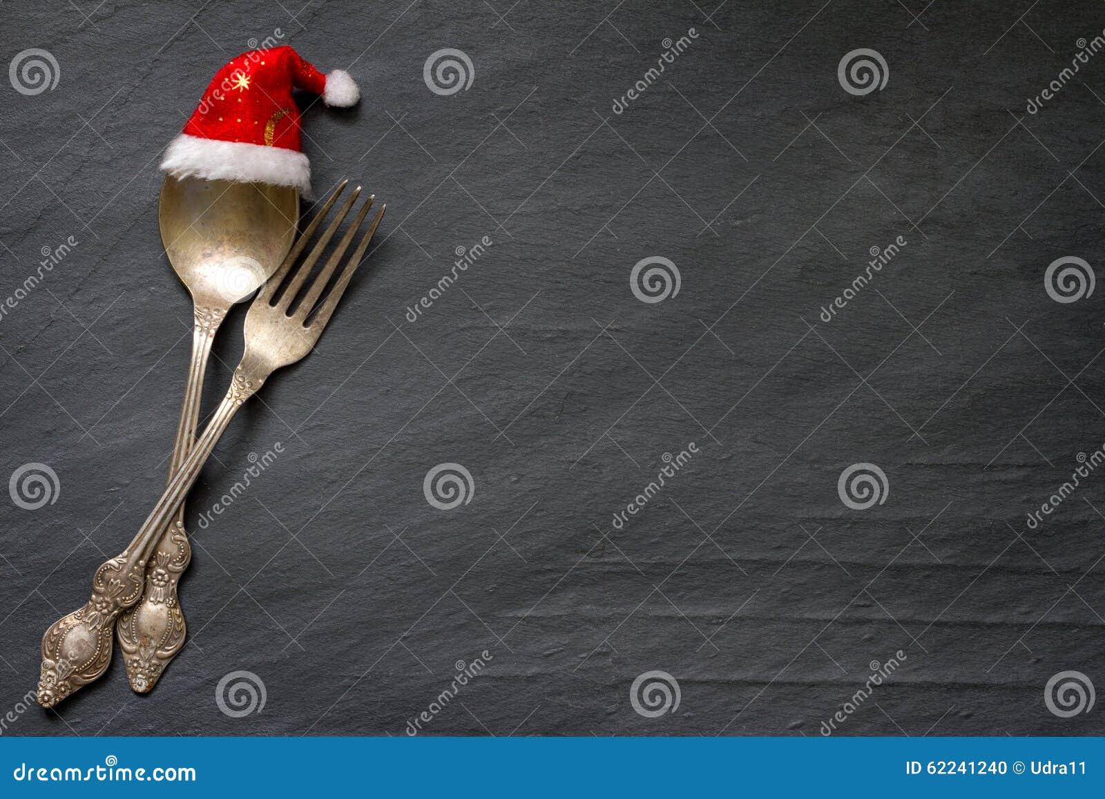 Cutelaria do Natal no fundo do alimento do sumário da tabela