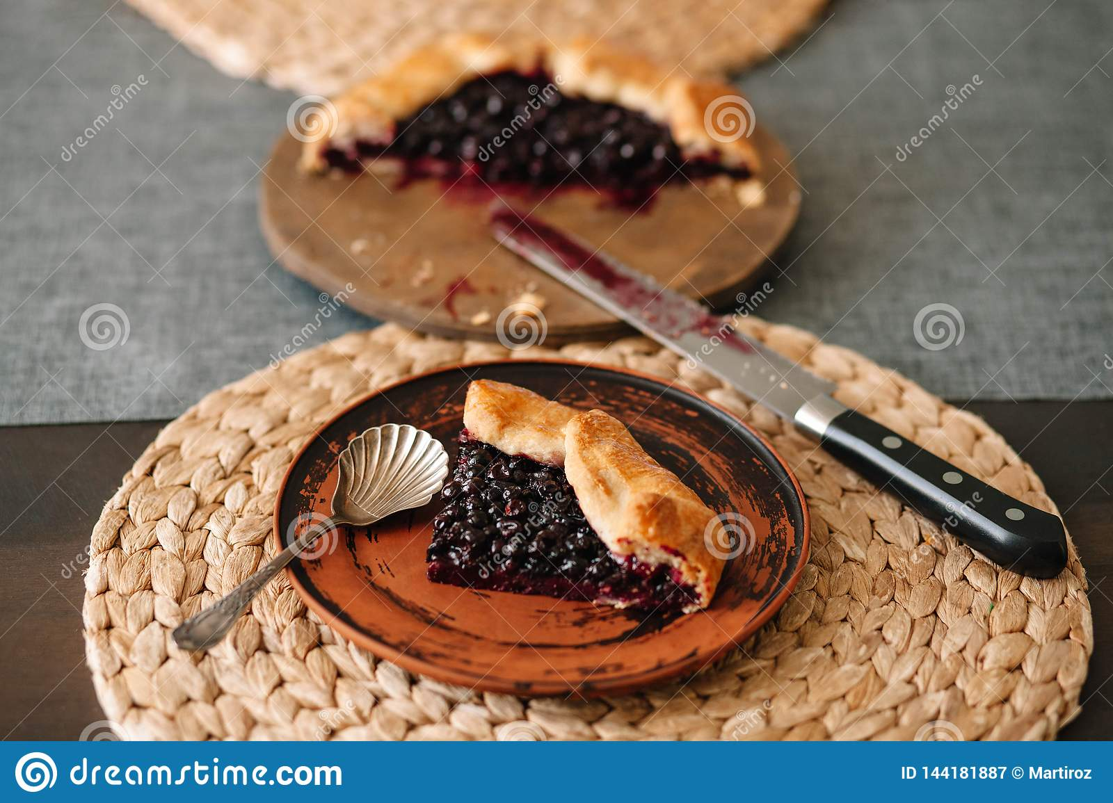 Cutted galette with seasonal berries. Flat lay crispy summer berry pie on a background with copy space
