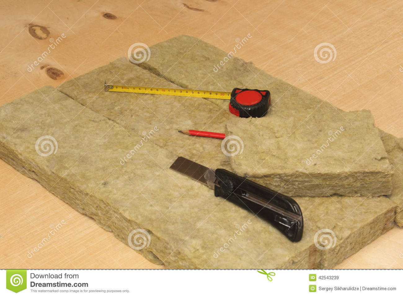 Cutted mineral wool, knife, pencil and tape-measure