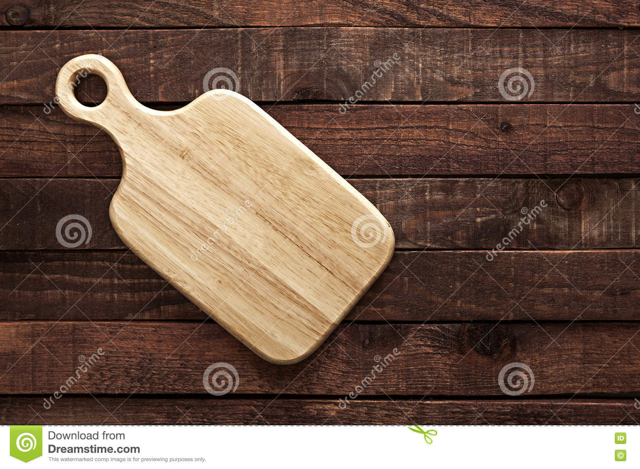 Dark wood table top - Cutting Board On Dark Old Wooden Table Top View