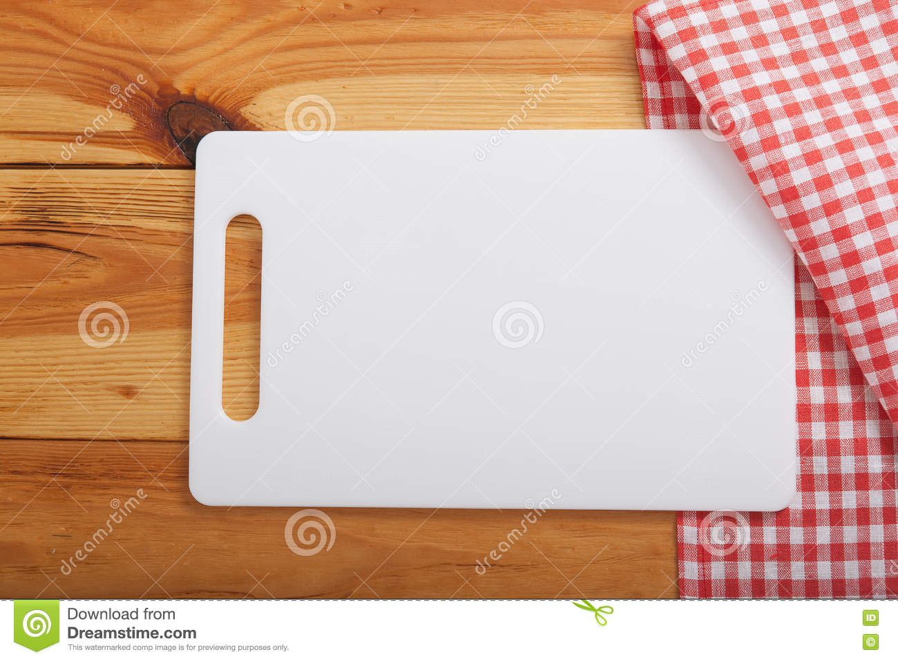 Cutting Board Over Towel On Wooden Kitchen Table Top View Stock