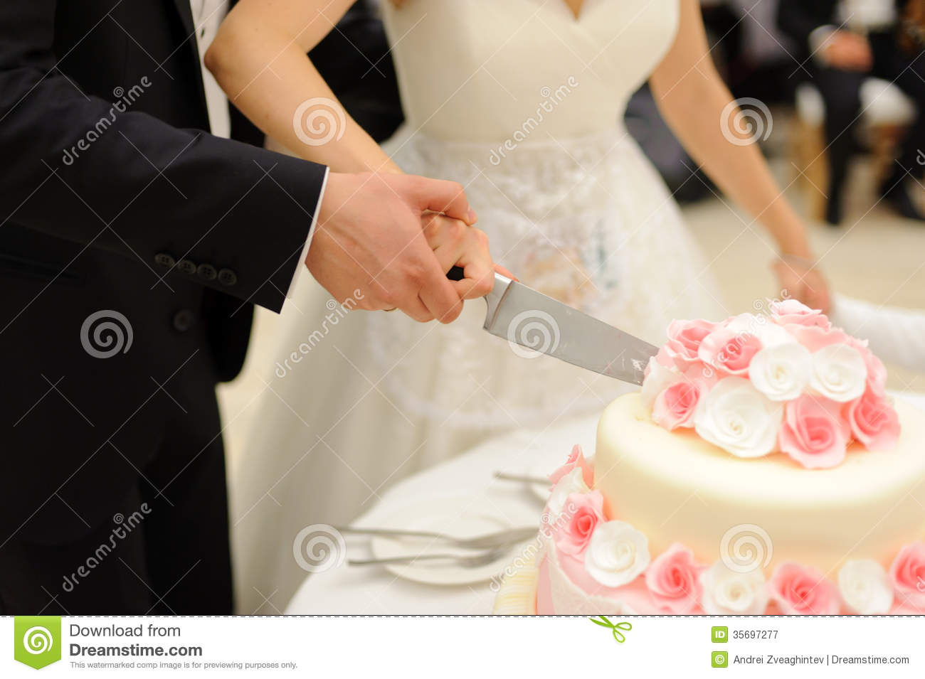 cutting a wedding cake cutting cake with roses stock image image of ornate 13284
