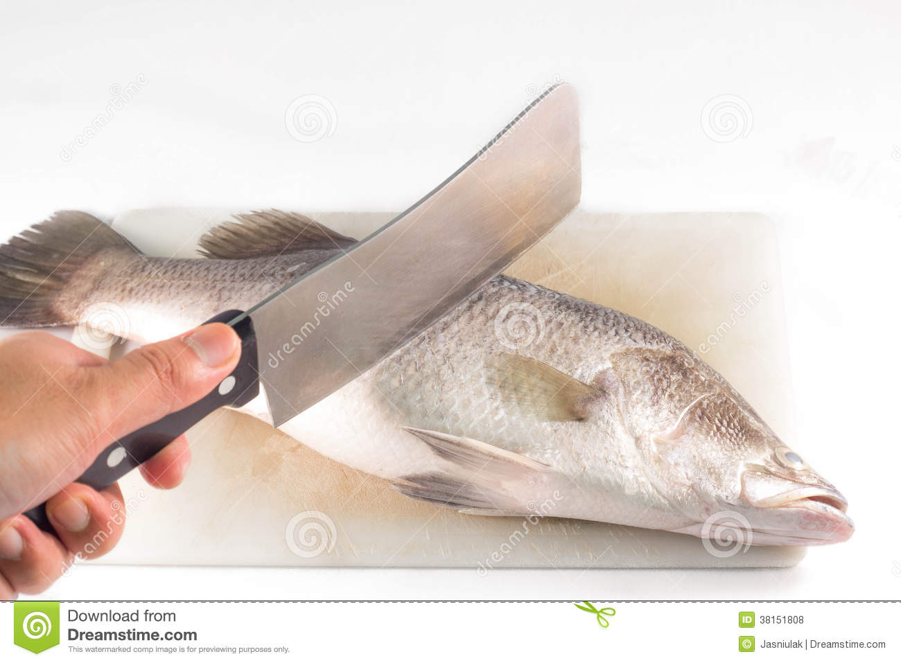 Cutting Fish With A Knife On Cutting Board. Royalty Free Stock Photos - Image: 38151808