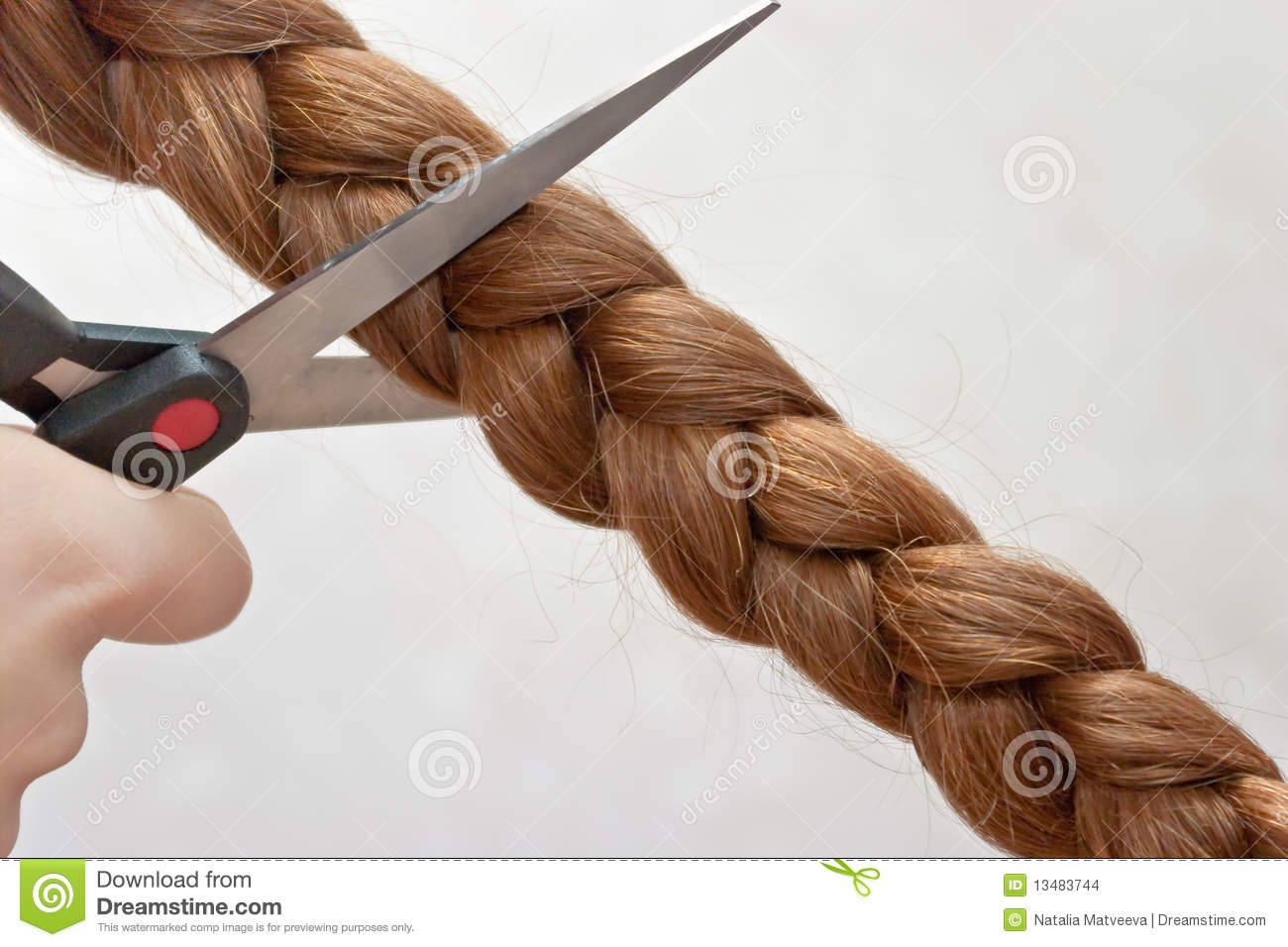 how to hold scissors while cutting hair