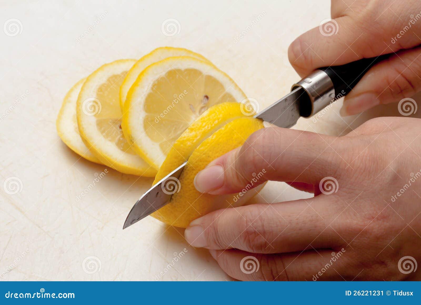 Cutting Lemon stock image. Image of grasp, slash, hand ...