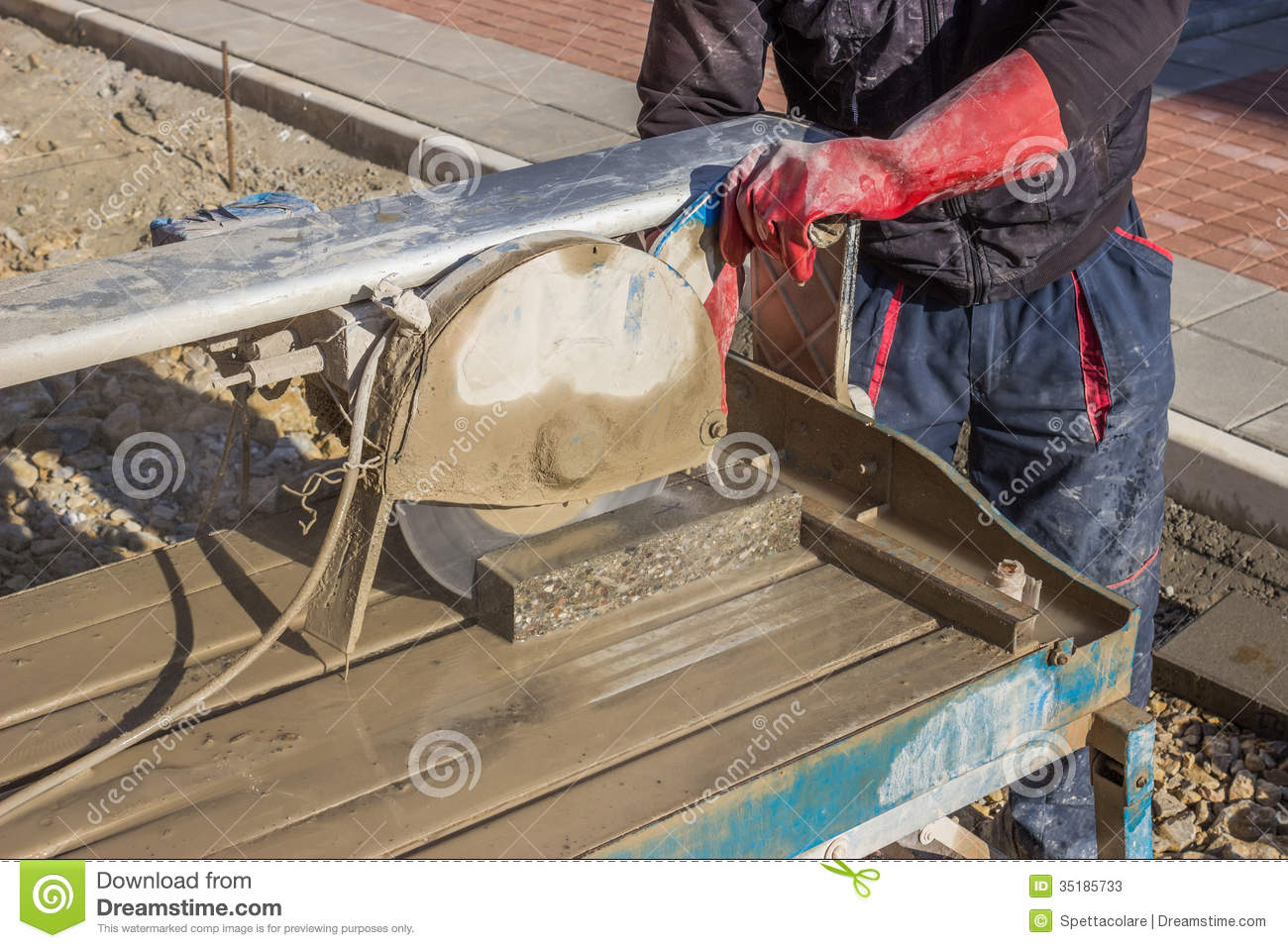 Cutting Pavings Stones With A Wet Saw 2 Stock Photos