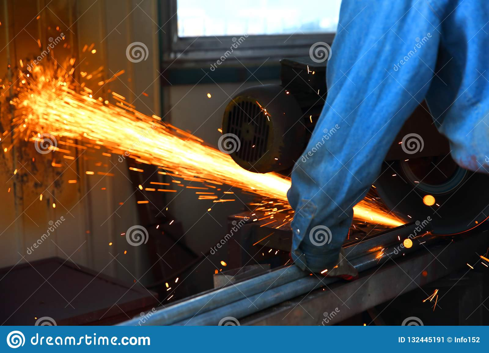 Cutting steel with a stationary grinder.