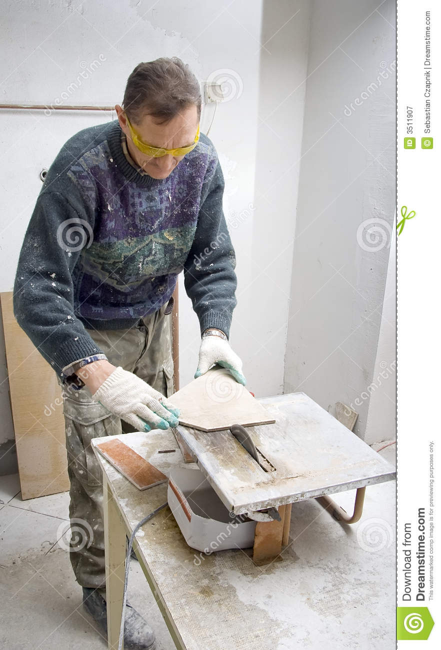 Tile Business Working : Cutting tiles royalty free stock photography image