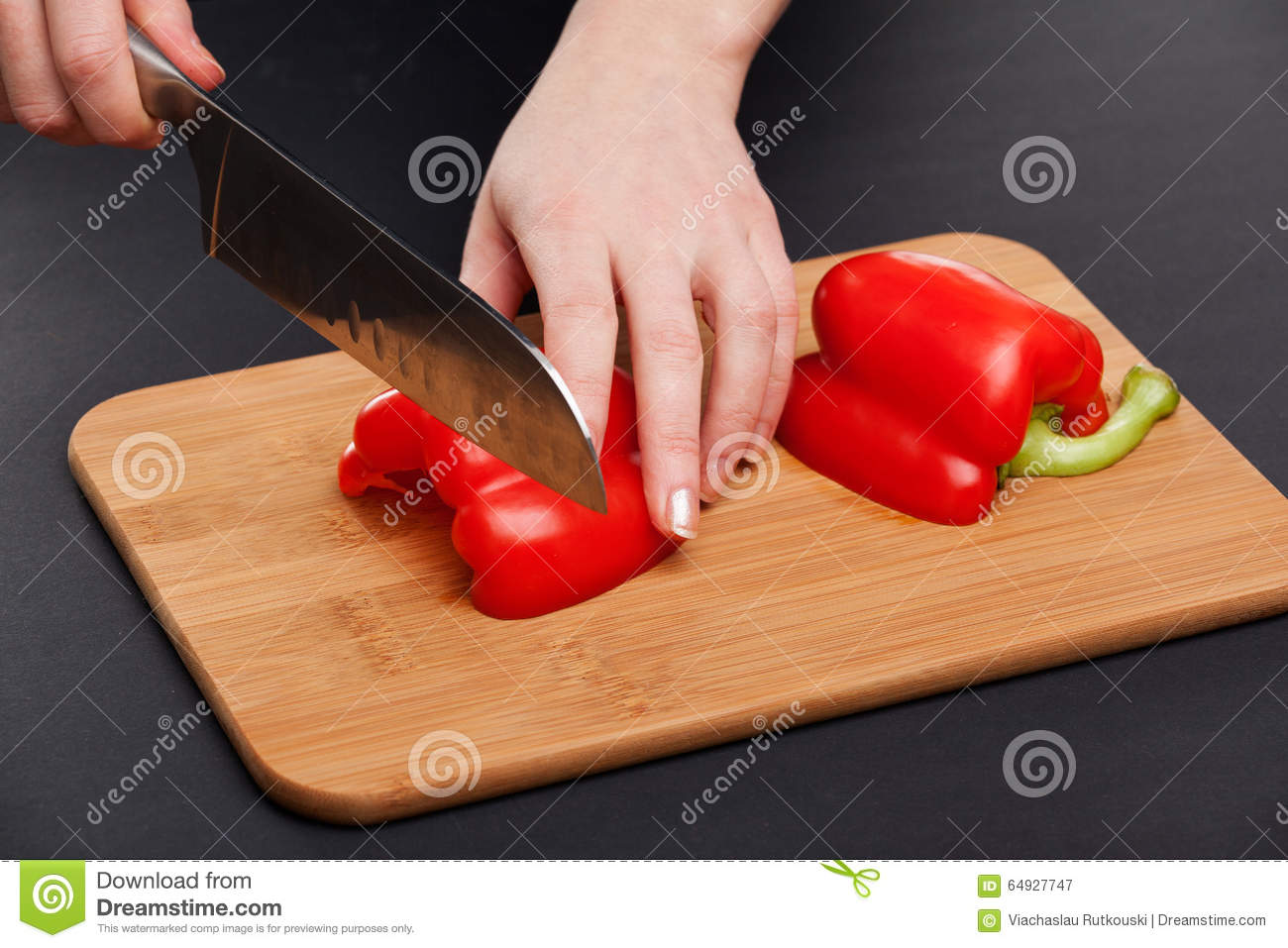 Cutting The Vegetables With A Kitchen Knife On The Board ...