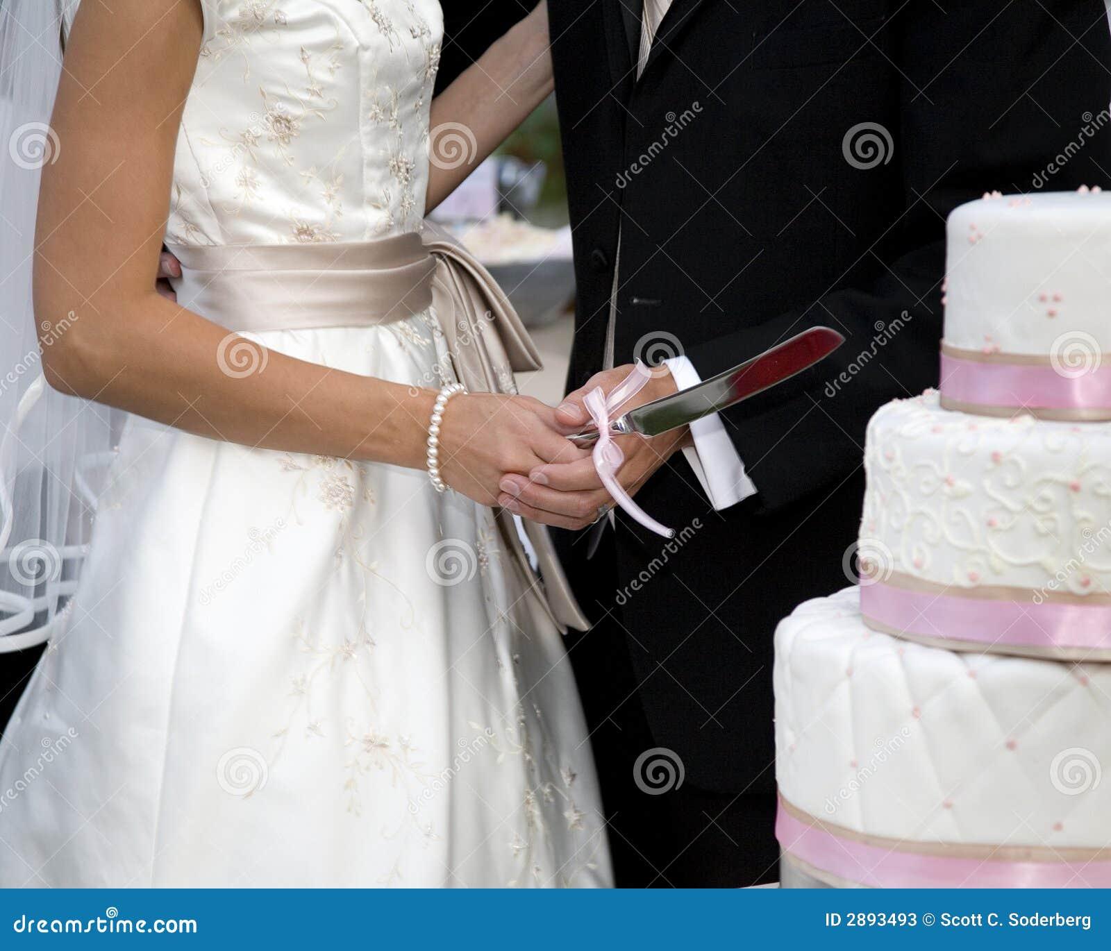 Cutting The Wedding Cake Stock Photos