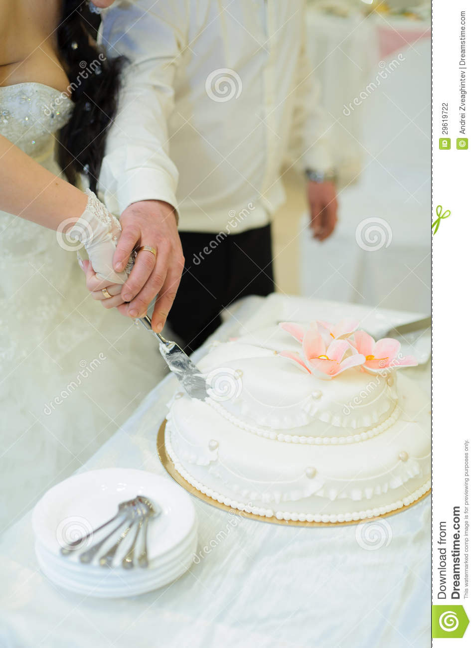 Cutting Cake Holding Hands Together
