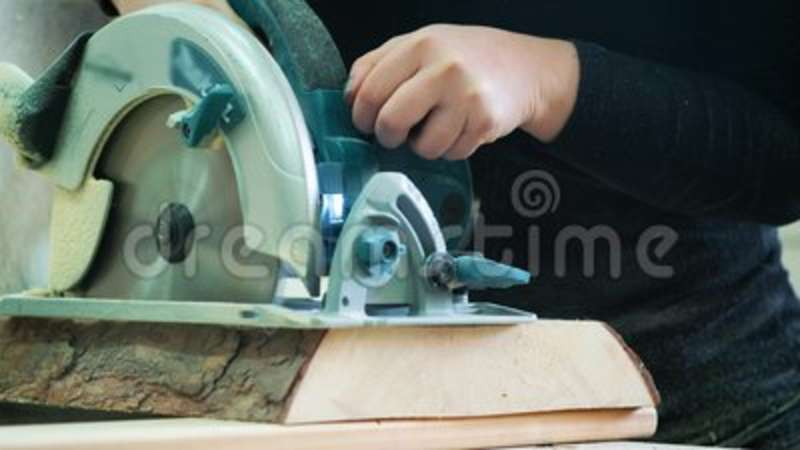 Cutting Wooden Floor By Electric Saw The Carpenter Saws A Log Or