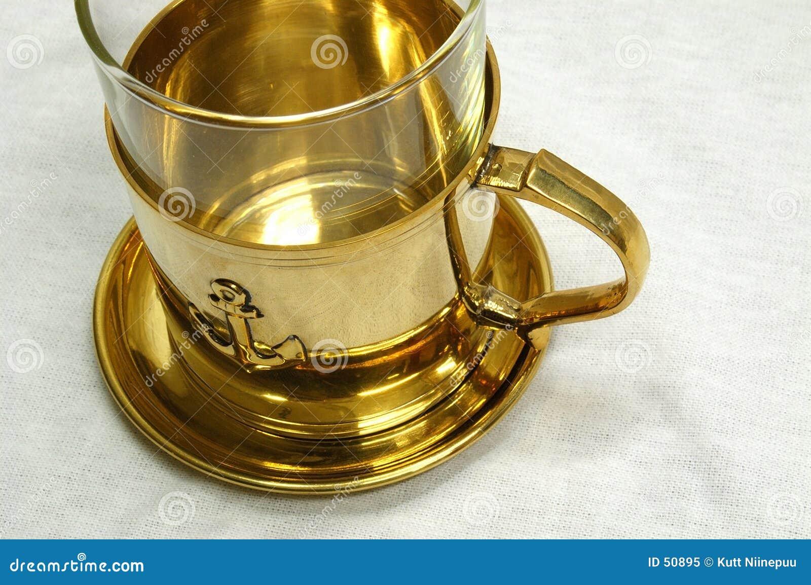 Download Cuvette de thé d'or image stock. Image du laiton, naval - 50895