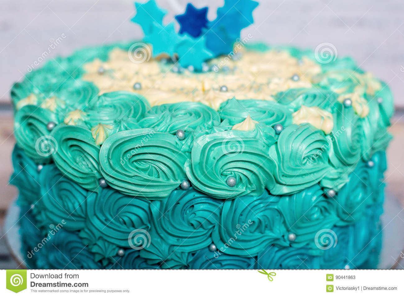 cyan and blue one layer birthday cake detail stock photo - image