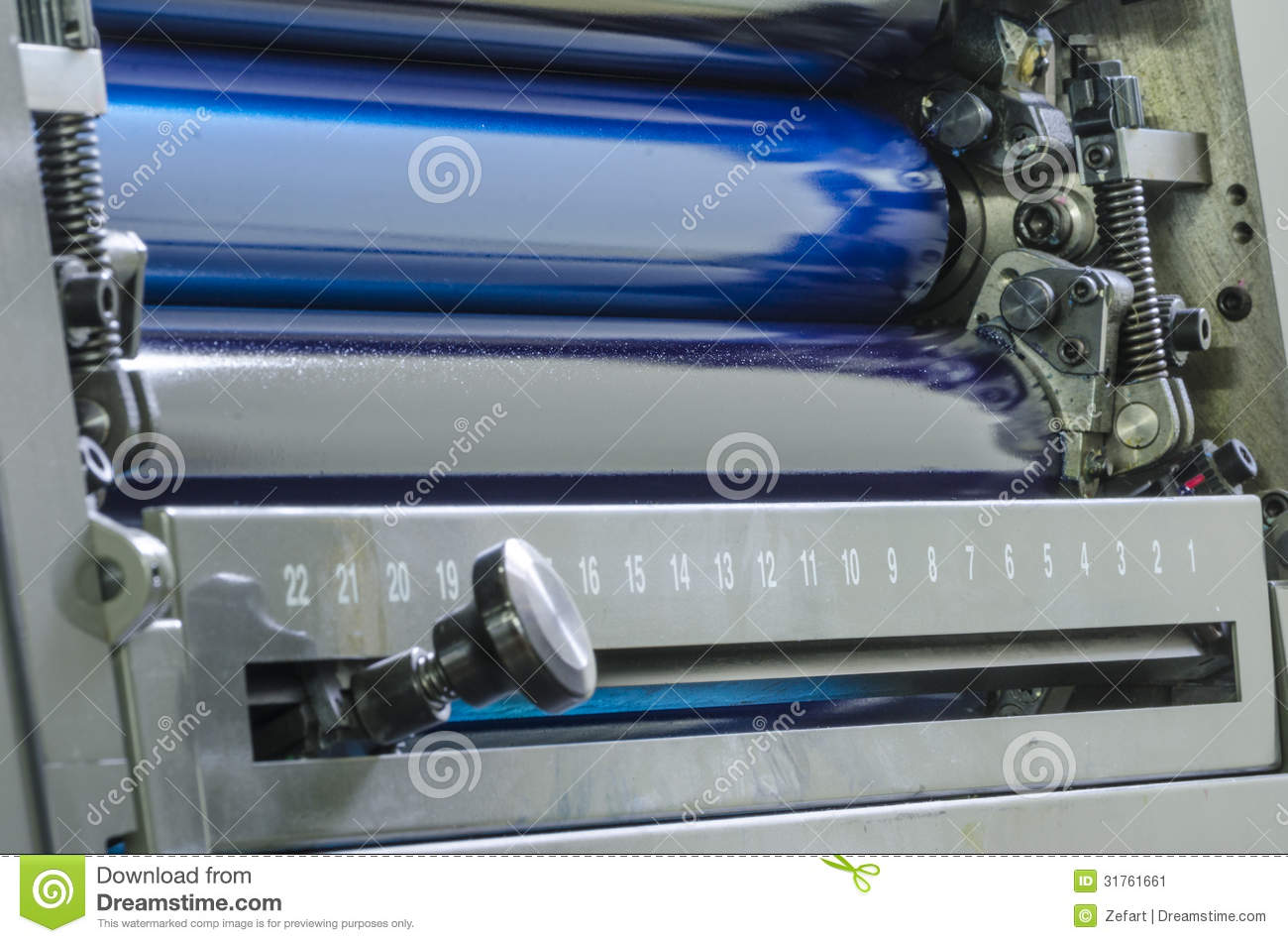 cyan ink color rollers of a offset color printing press close up