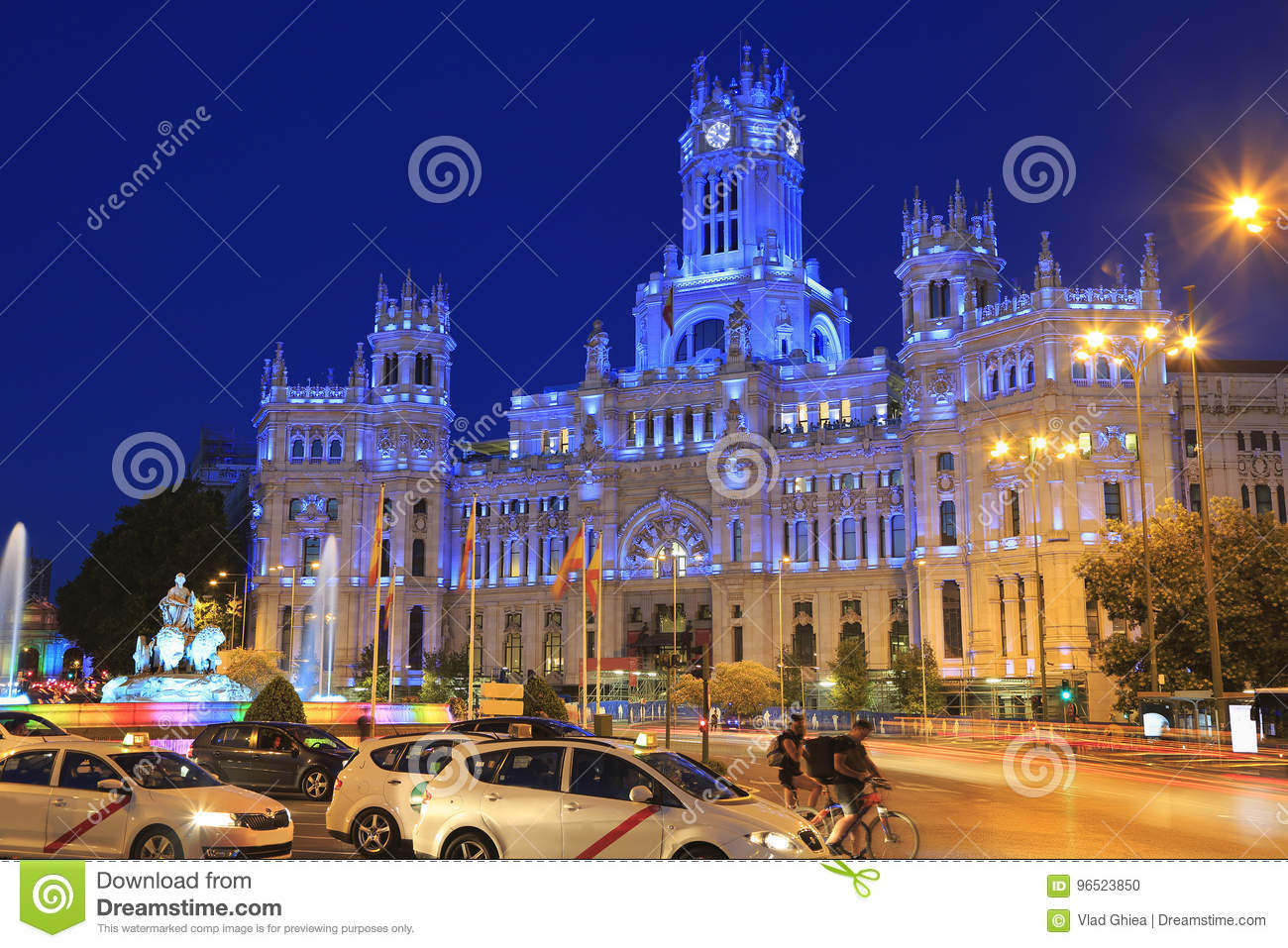 Cybele Palace and fountain illuminated at night in Madrid, Spain