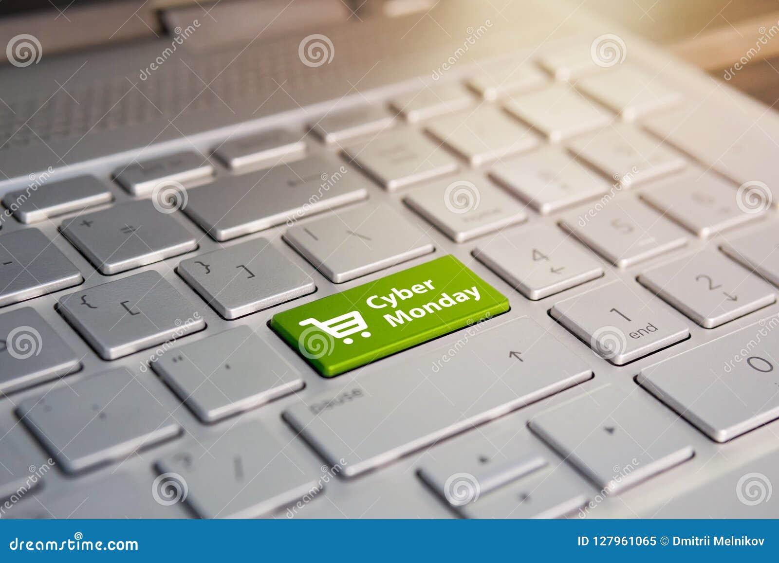 Cyber Montag und Einkaufslaufkatzensymbol auf Notizbuchtastatur On-line-Einkaufen an einem Rabatt Verkaufstag im Online-Shop