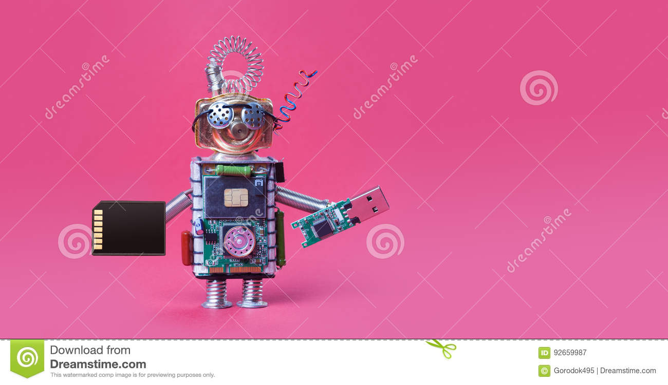 Cyber safety data storage concept. System administrator robot toy with usb flash stick and memory card on red background