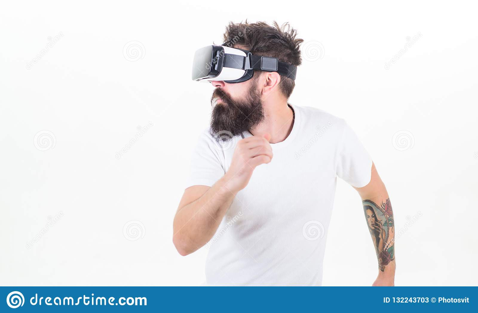Cyber sport. Guy with head mounted display interact virtual reality. Hipster play virtual sport game. Virtual race. Man