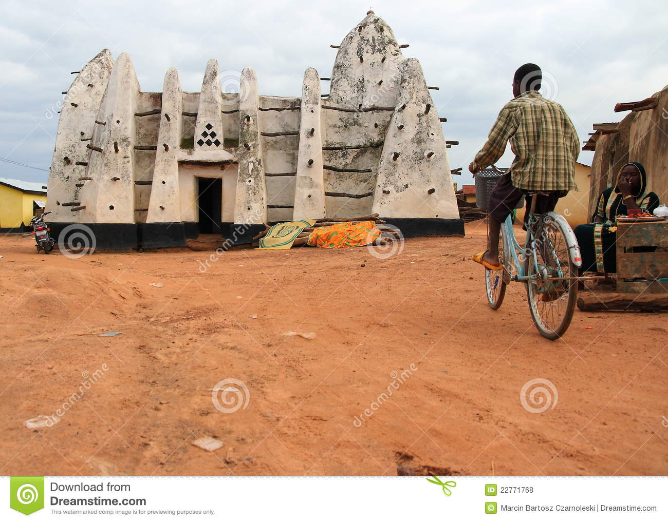 Cycling for the worship in a clay African mosque