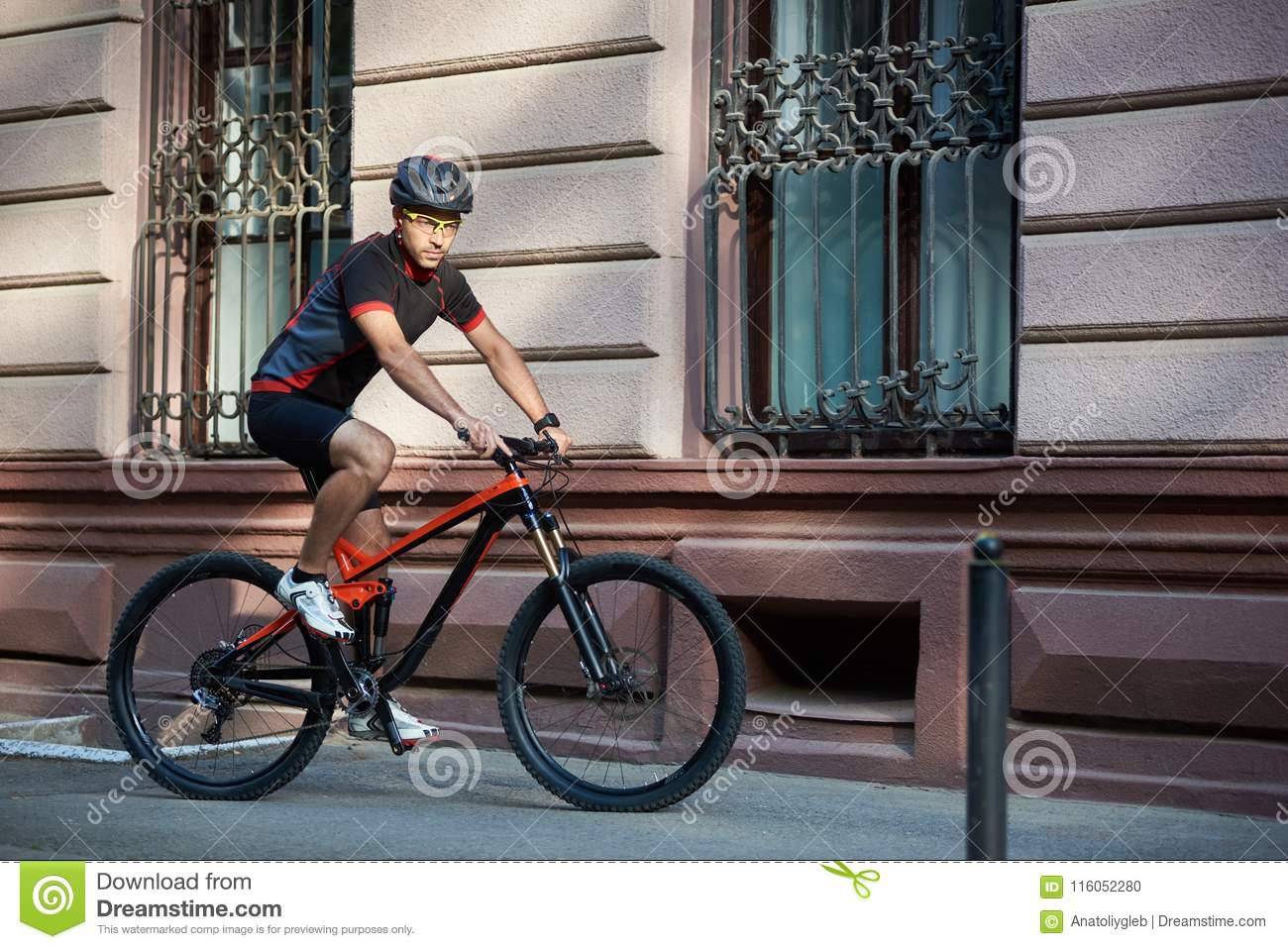 cyclist-riding-bike-along-old-historical-street-sporty-guy-biker- professional-cycling-clothes-protective-helmet-bicycle-116052280.jpg 4e9abb5e2