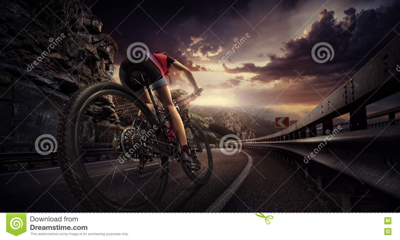 Download Cyclist riding a bike stock image. Image of water, sunset - 71588095