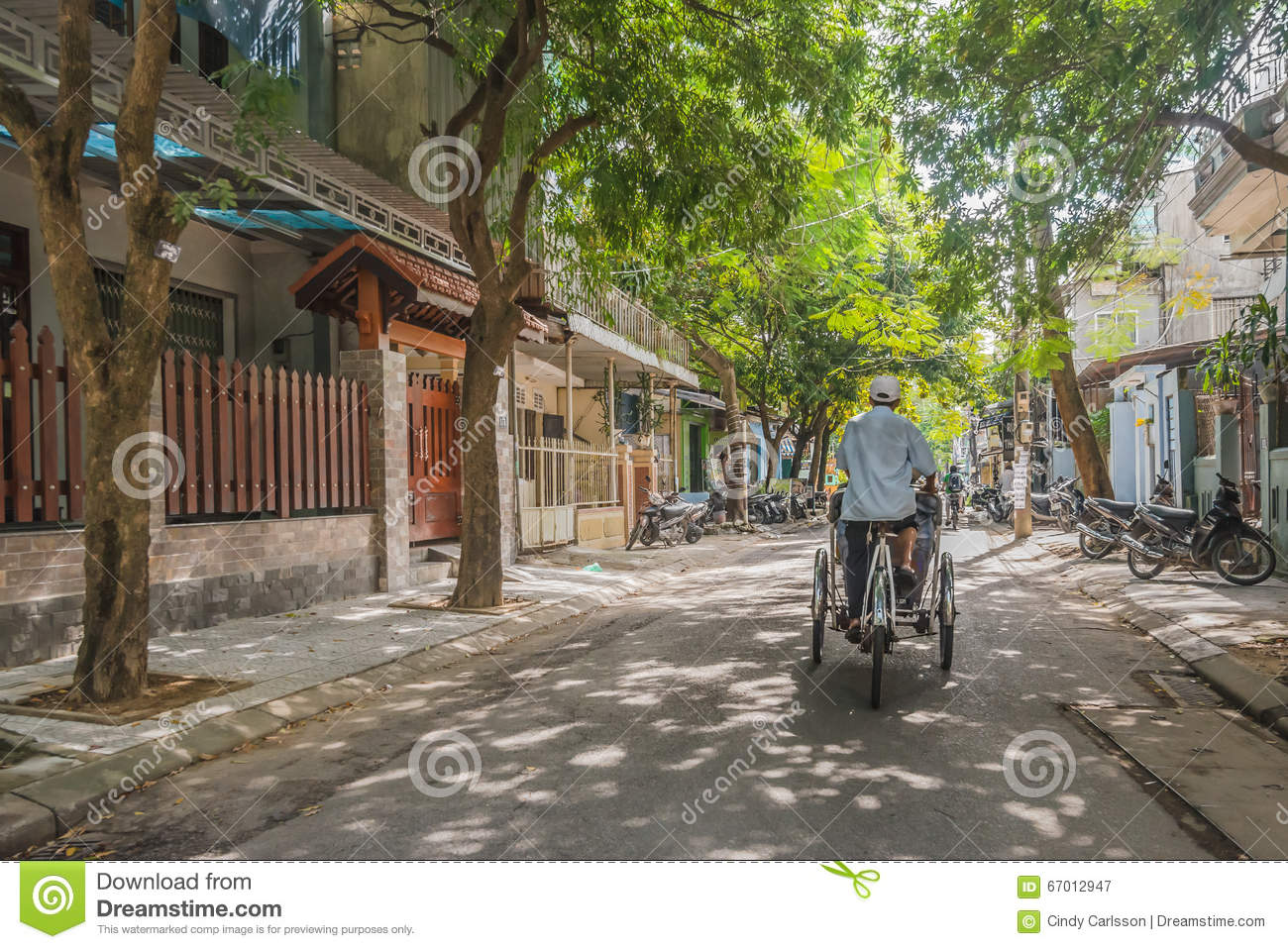 Cyclo on a quiet street in old Hue Vietnam