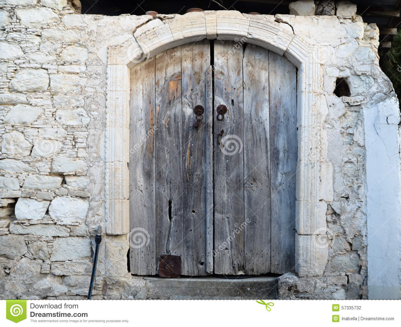 Cyprus Old Wooden Door With Surrounding White Stone Stock