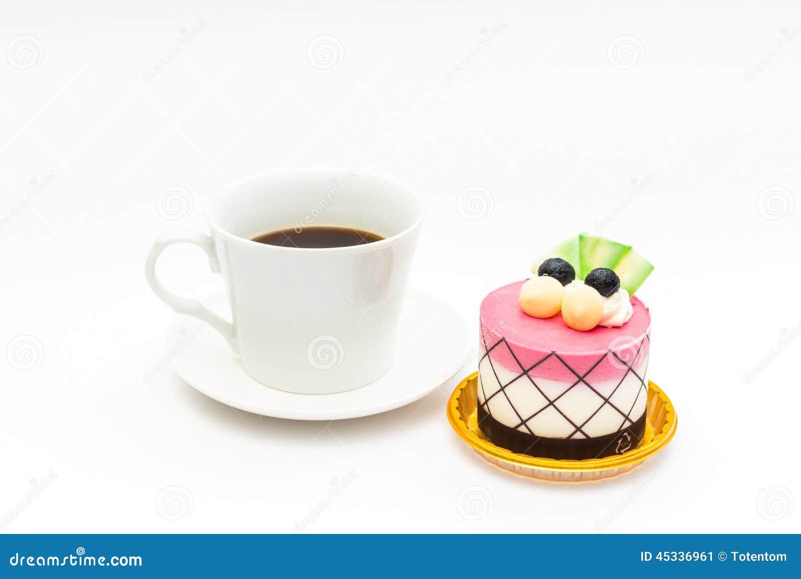 Czarnej jagody babeczka z czarną kawą w białym kawowym kubku