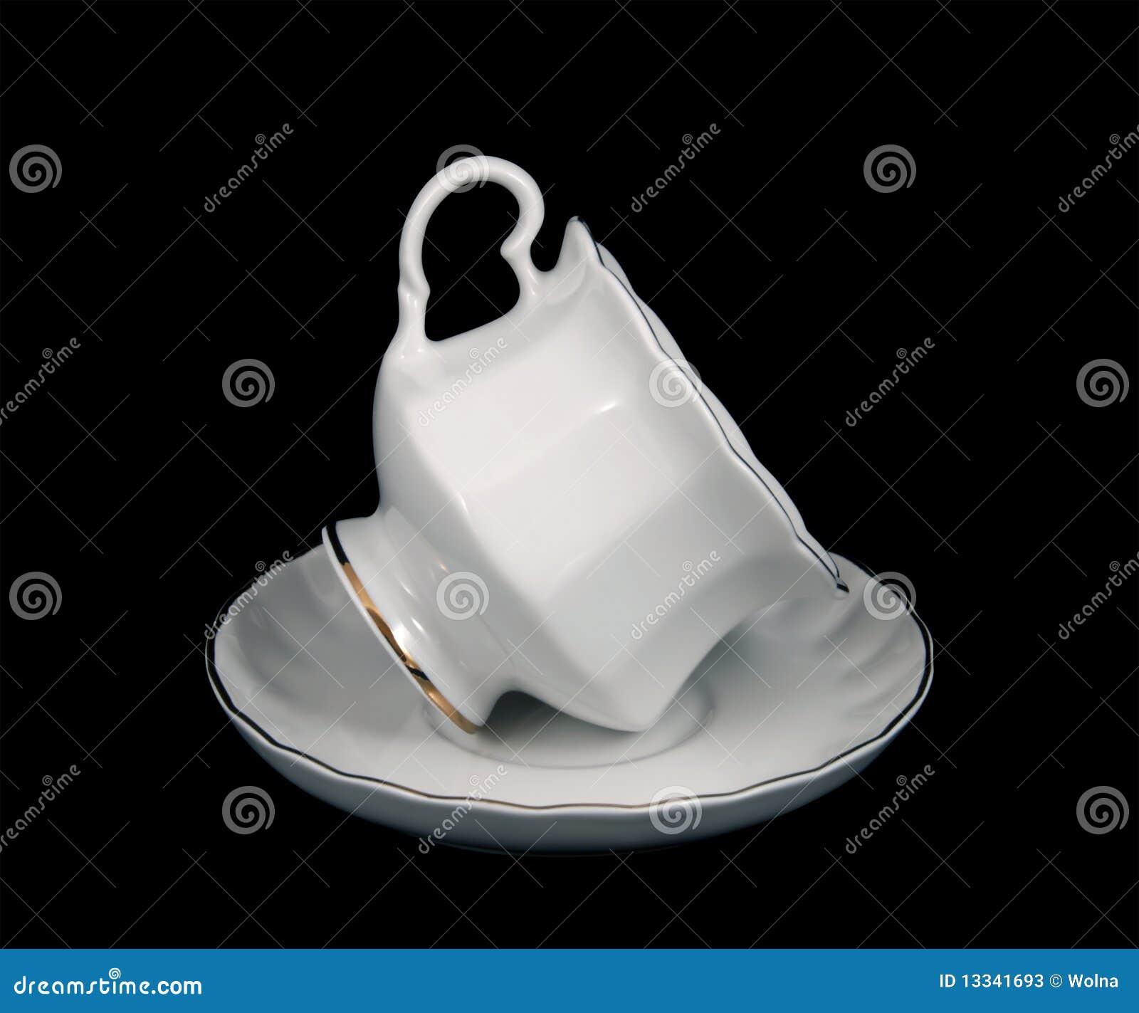 Czarny filiżanki spodeczka herbata