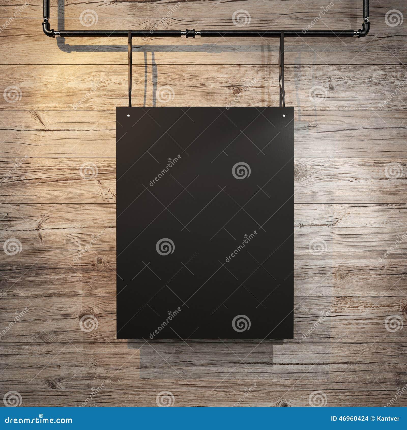 Czarny plakatowy obwieszenie na rzemiennym pasku na drewnianym tle