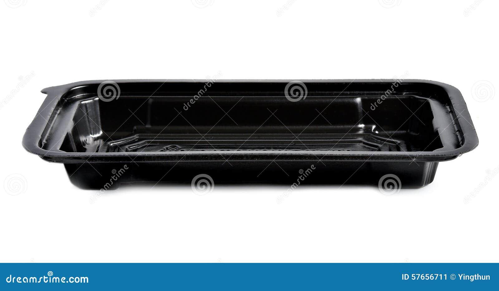 Czarny plastikowy taca bielu tło