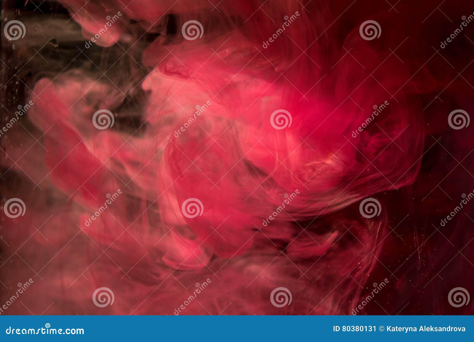 Czerwony Pomarańczowy Atrament W Wodzie światła Słonecznego