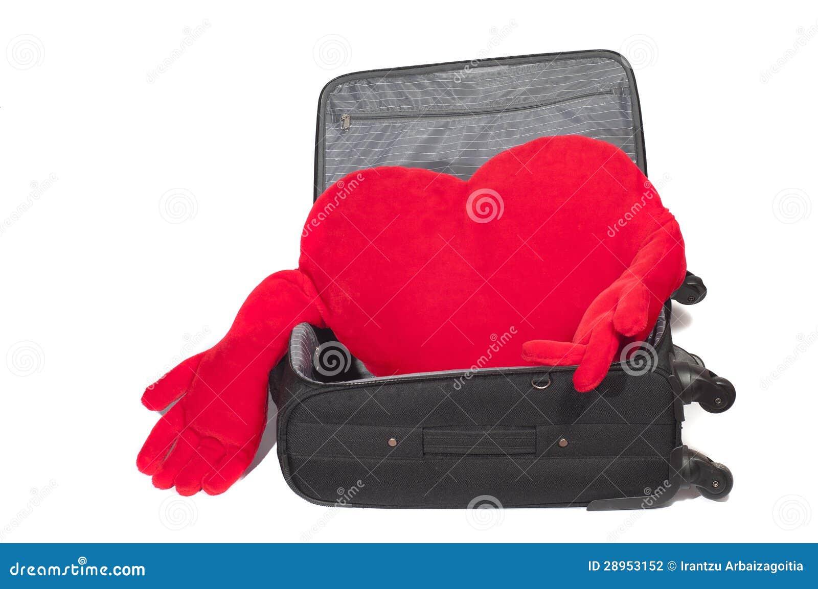 Czerwony sercowaty faszerujący wśrodku walizki