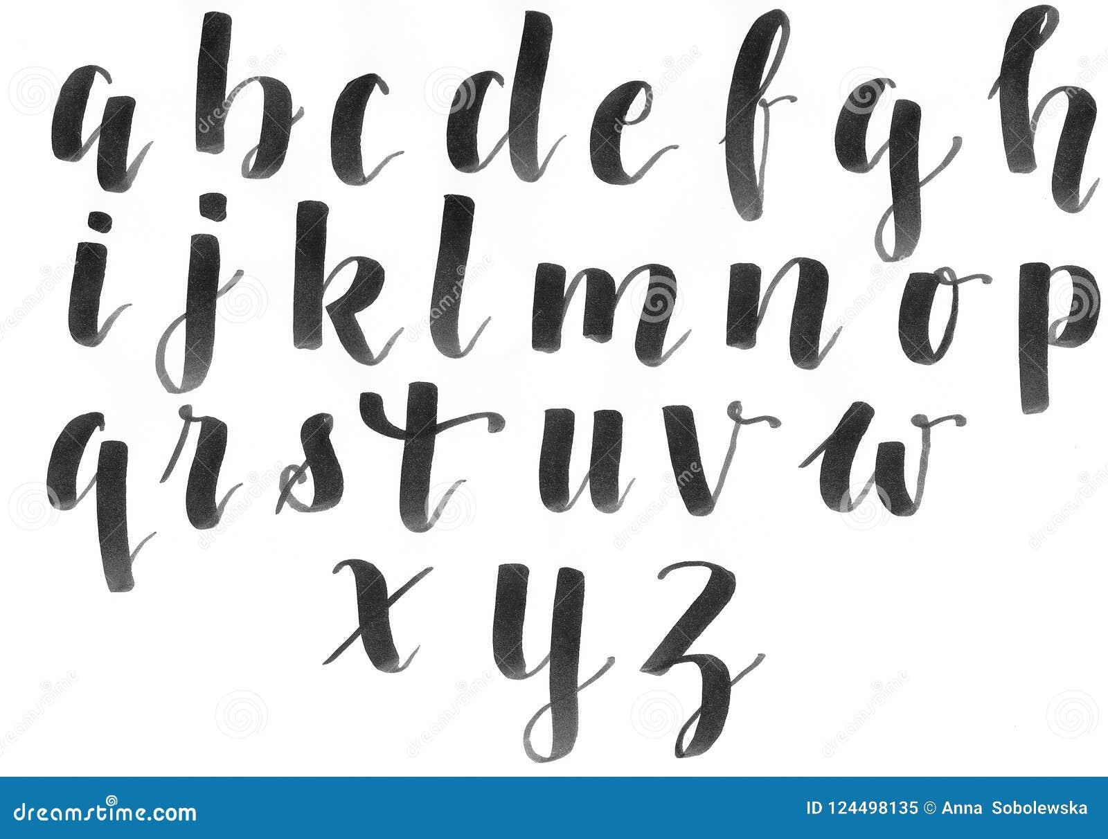 Dé las letras, alfabeto moderno de la caligrafía en negro en un Libro Blanco, manuscrito con una fuente personal