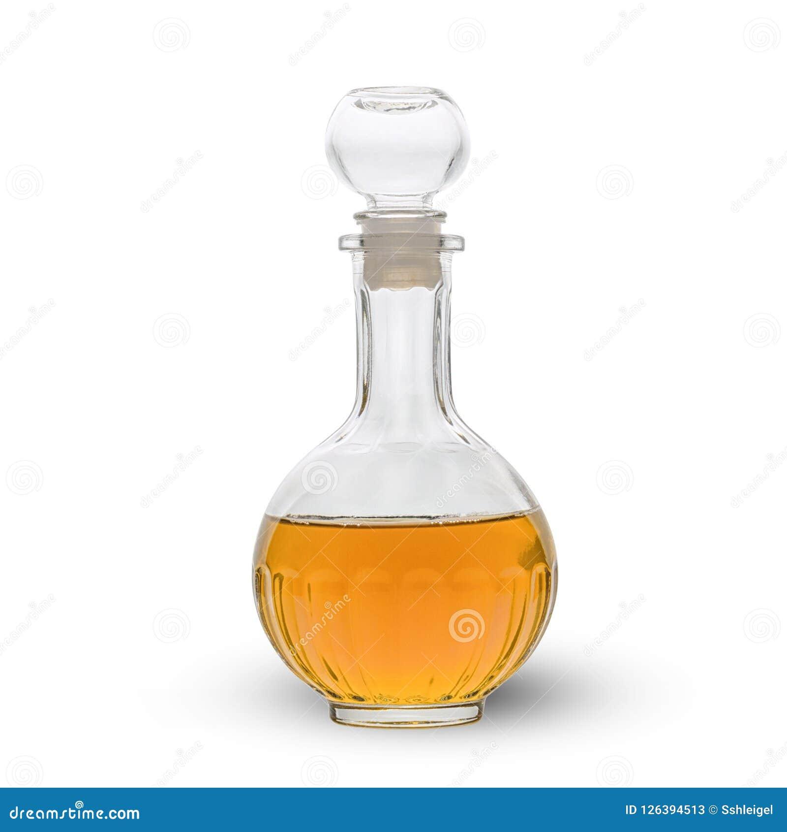 Décanteur rempli du vinaigre de cidre de pomme d isolement