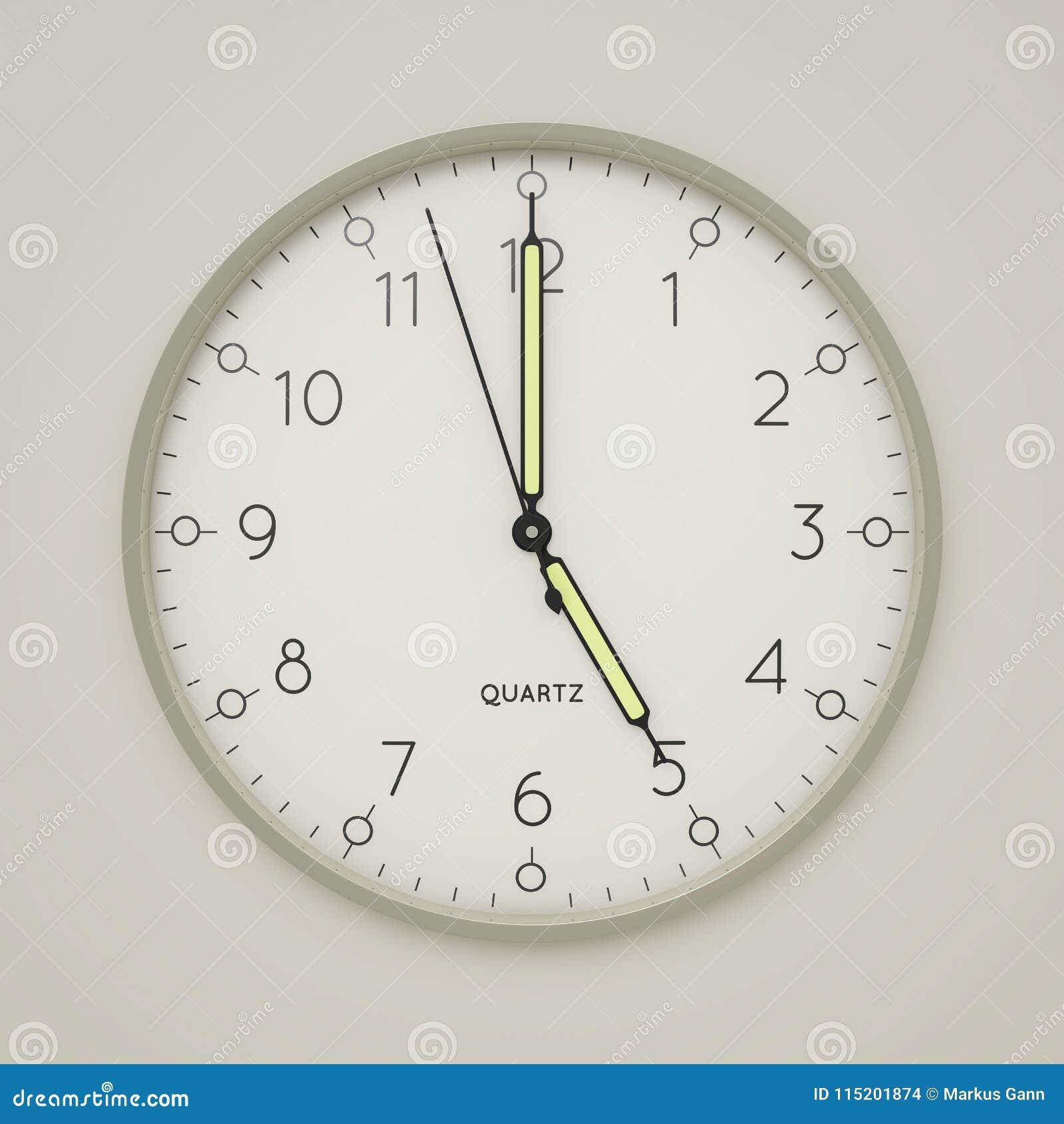a clock shows 5 o  clock