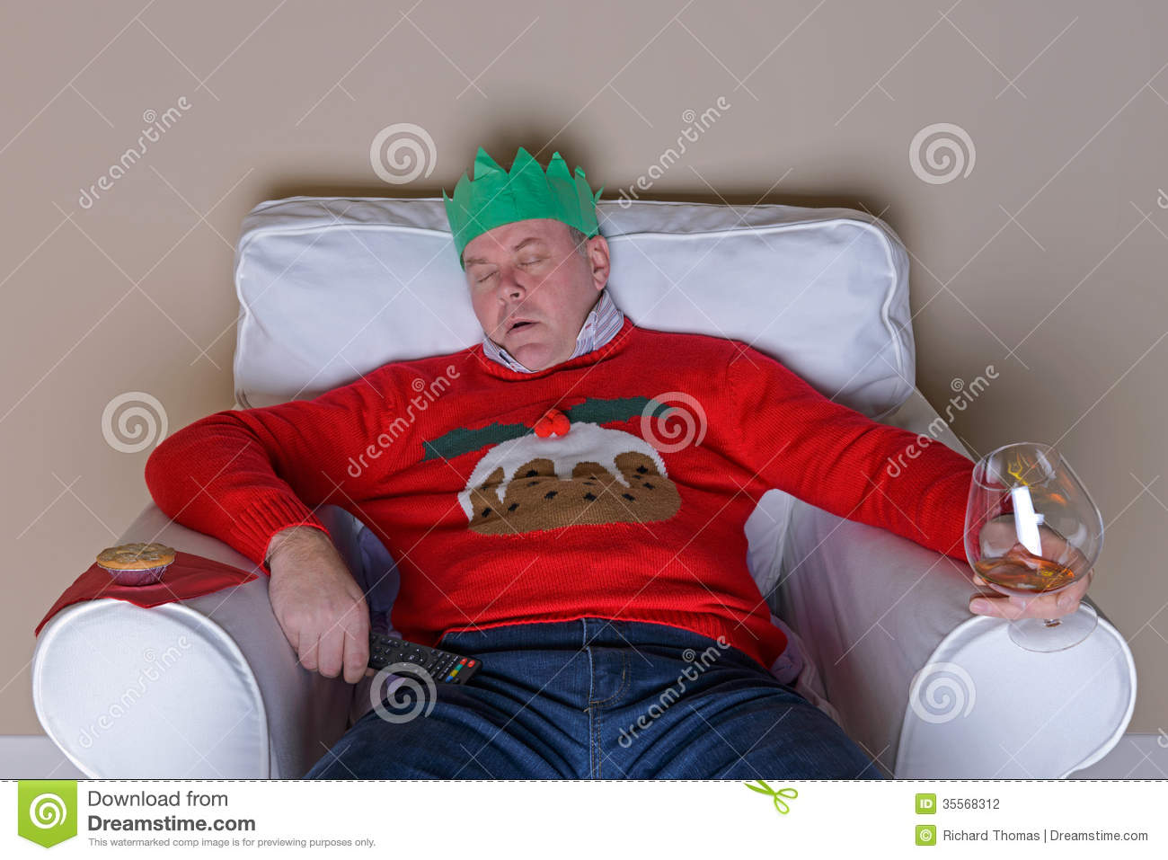 Dad Asleep In A Chair On Christmas Day Stock Photography