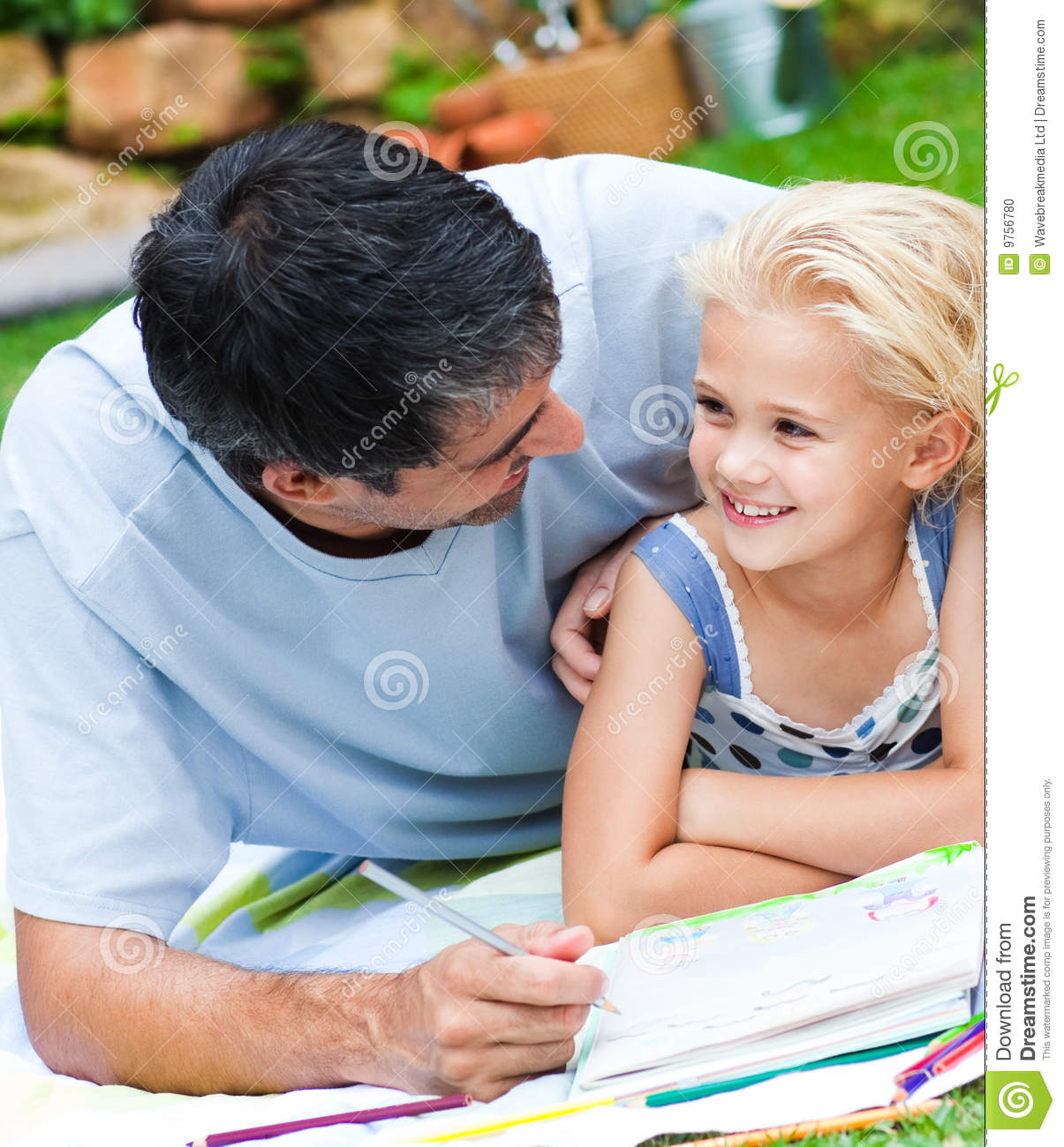 Dad And Daughter Doing Homework In A Garden Stock Photo - Image ...